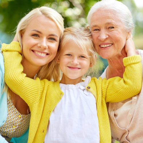 Multi-generational family of a grandmother, mother, and young daughter